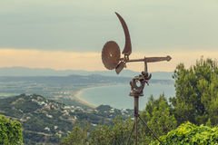 Old wind vane on a landscape Royalty Free Stock Photos