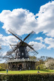 Old Windmil in Malmo. Old windmill in Malmo Royal park (Kungsparken) with people enjoying the warm spring day in Sweden Royalty Free Stock Photos