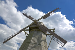 Old windmill. On blue sky background Royalty Free Stock Images