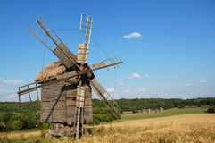 Old windmill. Old  mill on to the meadow, Ukraine Stock Photos
