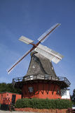 Old windmill. With background of blue sky Royalty Free Stock Photography