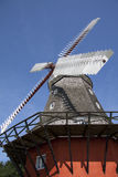 Old windmill. With background  of blue sky Royalty Free Stock Images