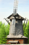 Old windmill. Old wooden windmill in the trees windmills in the clearing - Russia, Arkhangelsk Royalty Free Stock Photography