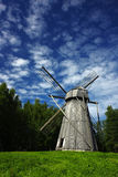 Old windmill. In a rural scene, a symbol of ancient alternative energy generation Stock Photography