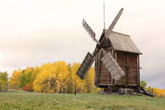 Old windmill. Old wooden windmill in the trees windmills in the clearing - Russia, Arkhangelsk Royalty Free Stock Images