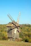 Old windmill. Antique ramshackle wooden windmill, Pirogovo, Kiev, Ukraine Royalty Free Stock Photo