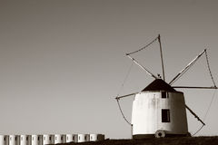 Old windmill. In Serpa, Portugal. The structures on the bottom left corner are wheat silos. Image unsharpened Royalty Free Stock Photography