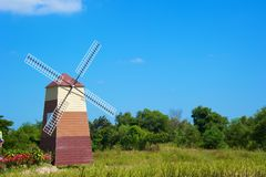 Old windmill. Windmill and old house barn, Thailand Royalty Free Stock Image