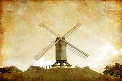 Old windmill. Windmill on the hill  - photo in retro style Royalty Free Stock Image