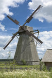 Old windmill. Meadow and blue sky Stock Photo