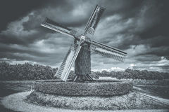 Old Windmill in action at dutch landscape Royalty Free Stock Images