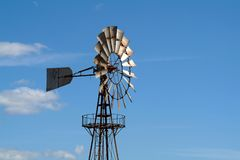 Old Windmill against blue sky Royalty Free Stock Images