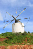 Old windmill in Algarve, Portugal Stock Photo