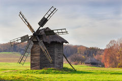 Old windmill on a background of forest and sky Royalty Free Stock Image