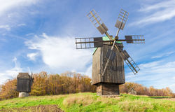 Old windmill on a background of forest and sky Stock Image
