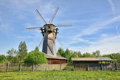 The Old Windmill Behind a Fence in Spring Royalty Free Stock Photo