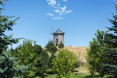 Old windmill and blue sky stock photo