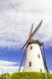 Old windmill with blue sky. View on Old windmill with blue sky royalty free stock photo