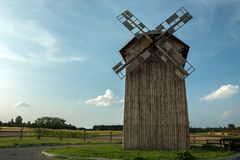Old windmill and blue sky. Wooden old windmill and blue sky stock photos