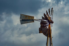 Old windmill. Old, broken and rusty water pump windmill from farm in rural Texas Royalty Free Stock Images
