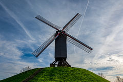 Old windmill in Bruges on a beautiful day, Belgium stock images