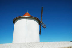 Old windmill in Capo Grosso, Corsica. Royalty Free Stock Photography