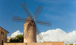 Old windmill with clouds behind Royalty Free Stock Photography