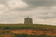 Old windmill on a cloudy day royalty free stock photos
