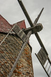 Old windmill. On cloudy sky Stock Images