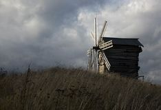 Old Windmill and cloudy sky Stock Images