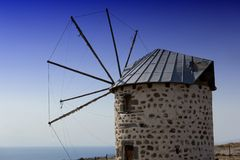 Windmill on the coast Stock Images