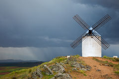 Old  Windmill on dramatic sky and rain Royalty Free Stock Photos