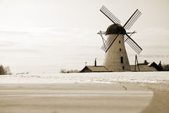 Old windmill in Estonia. A photo of an old windmill behind the snow field at winter Stock Images