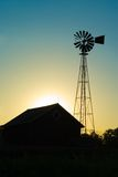 Old Windmill & Farm House. Silhouette of Old Windmill and Farm House Stock Photo