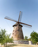 Old windmill on a farm. Old wooden Dutch-style windmill on a farm Stock Image