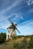 Old windmill on Faro, Sweden. Old windmill of smock mill type on the island Faro north of Gotland, Sweden Stock Photos