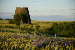 Old windmill in field Stock Images