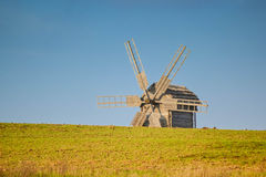Old windmill on the field Stock Images