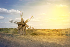 Old windmill on the field Stock Image
