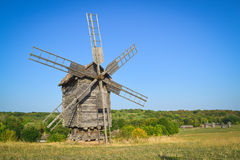 Old windmill. In the field under blue sky royalty free stock photography