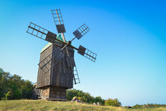 Old windmill. In the field under blue sky royalty free stock photos
