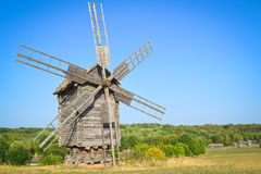 Old windmill. In the field under blue sky royalty free stock image