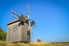 Old windmill. In the field under blue sky stock photos