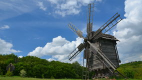 Old windmill and floating clouds stock video footage
