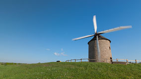 Old Windmill in a Green Field Royalty Free Stock Photography