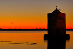 Old windmill in harbor of orbetello Royalty Free Stock Photo