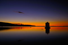 Old windmill in harbor of orbetello Royalty Free Stock Images