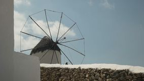Old windmill on the hill above chora, mykonos stock footage