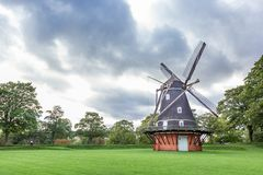 Old windmill in historical pak in Copenhagen. Denmark stock photos