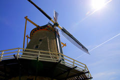 Old windmill in Holland with Sun. Old windmill in the blue sky with the sun stock image